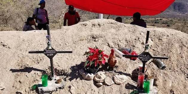 Community residents in Guerrero state in Mexico watch over a memorial for two demonstrators killed Nov. 18, 2017, near the mining operations of Canada's Torex Gold.