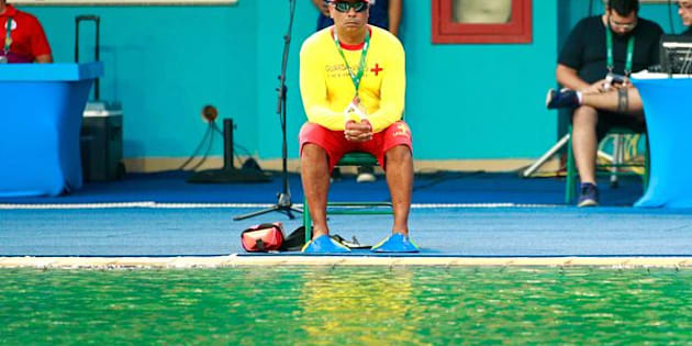 RIO DE JANEIRO, BRAZIL - AUGUST 09:  A lifeguard sits by the edge of the diving pool during the Women's Diving Synchronised 10m Platform Final on Day 4 of the Rio 2016 Olympic Games at Maria Lenk Aquatics Centre on August 9, 2016 in Rio de Janeiro, Brazil.  (Photo by Adam Pretty/Getty Images)