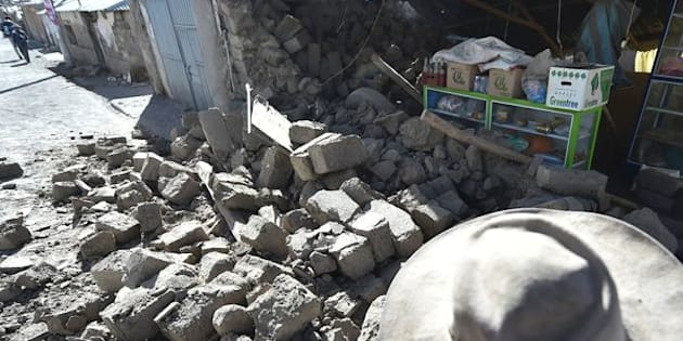 A woman observes the damage in her home on August 15, 2016 in the Andean town of Yanque in southern Peru caused by a 5.3 magnitude earthquake that struck this remote picturesque region in the state of Arequipa on Sunday night. At least four other people also died and 68 were injured, most by toppling buildings. Rescue and aid efforts have been hampered by more than 60 replica aftershocks that have rocked the area, which is popular with tourists, in the past 24 hours.  / AFP / Jose Sotomayor Jimenez        (Photo credit should read JOSE SOTOMAYOR JIMENEZ/AFP/Getty Images)