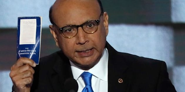 Khizr Khan, whose son, Humayun S. M. Khan was one of 14 American Muslims who died serving in the U.S. Army  in the 10 years after the 9/11 attacks, offers to loan his copy of the Constitution to Republican U.S. presidential nominee Donald Trump, as he speaks during the last night of the Democratic National Convention in Philadelphia, Pennsylvania, U.S. July 28, 2016. REUTERS/Mike Segar