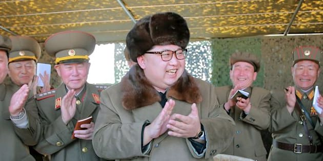 North Korean leader Kim Jong Un claps during a demonstration of a new large-caliber multiple rocket launching system at an unknown location, in this undated photo released by North Korea's Korean Central News Agency (KCNA) on March 22, 2016. REUTERS/KCNA/File Photo  ATTENTION EDITORS - THIS PICTURE WAS PROVIDED BY A THIRD PARTY. REUTERS IS UNABLE TO INDEPENDENTLY VERIFY THE AUTHENTICITY, CONTENT, LOCATION OR DATE OF THIS IMAGE. FOR EDITORIAL USE ONLY. NOT FOR SALE FOR MARKETING OR ADVERTISING CAMPAIGNS. THIS PICTURE IS DISTRIBUTED EXACTLY AS RECEIVED BY REUTERS, AS A SERVICE TO CLIENTS. NO THIRD PARTY SALES. SOUTH KOREA OUT. NO COMMERCIAL OR EDITORIAL SALES IN SOUTH KOREA
