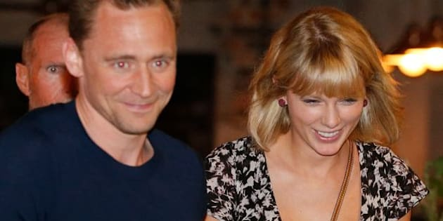 "Actor Tom Hiddleston and singer Taylor Swift having a grand old time during Tom's ""high profile summer."""