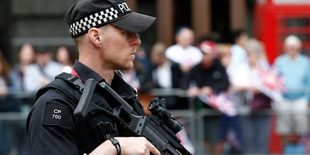 An armed police officer patrols ahead of the arrival of members of Britain's royal family to a service of thanksgiving for Queen Elizabeth's 90th birthday at St Paul's cathedral in London, Britain, June 10, 2016. REUTERS/Peter Nicholls
