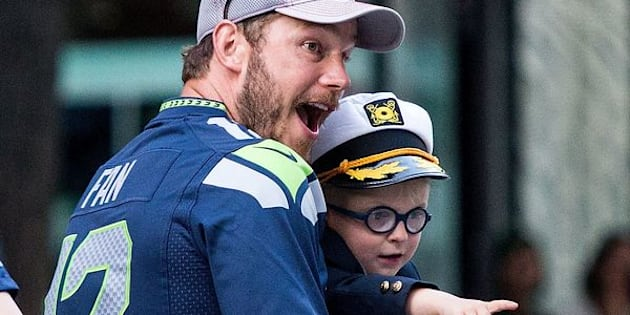 Chris Pratt and son Jack Pratt ride in the Seafair Torchlight Parade Grand Marshal vehicle on July 30, 2016 in Seattle, Washington.