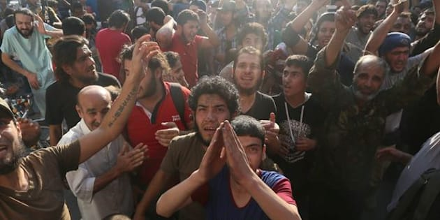 Syrian rebels said they had broken through to besieged opposition-held areas in eastern Aleppo on Saturday. Above, rebels and civilians celebrate in Aleppo.