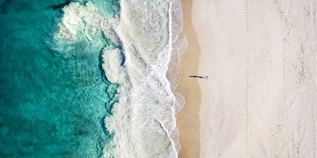 Just one person walking along Perth's Floreat Beach becomes a work of art with drone photography.