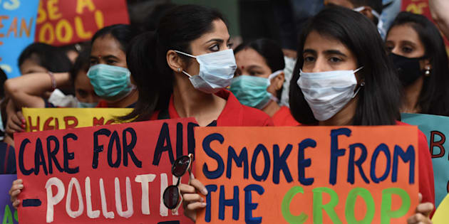 People wear pollution masks during the protest march for 'Your Right To Breathe' at Jantar Mantar, on November 6, 2016 in New Delhi. (Photo by Virendra Singh Gosain/Hindustan Times via Getty Images)