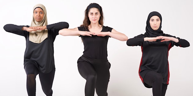 Thawrih co-founder Sarah Abood (centre) lunges with one of her employees and a model.
