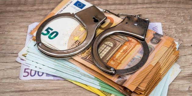 Handcuffs on the euro bills. crime concept