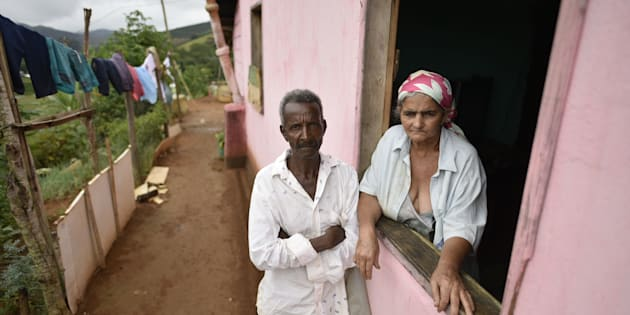 Pedro Joel de Oliveira and Teresinha Gomes de Oliveira, the parents of a victim of suspected yellow fever, stand at their home in the southeastern Brazilian state of Minas Gerais on Friday. Health authorities of Minas Gerais decreed a health emergency in 152 cities and towns due to a likely outbreak of yellow fever.