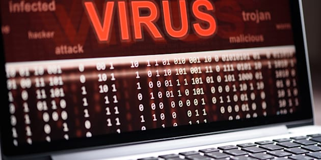 Computer virus protection concept. Alert of hacker attacks on the laptop screen