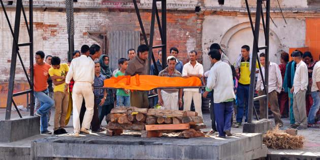 Pashupatinath, Nepal - October 8, 2013: Human cremation along the holy Bagmati River at Pashupatinath, the second most important cremation place for Hindus, after Varanasi, India