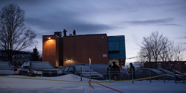 Police stand guard on the roof of the Islamic Cultural Center in Quebec City, Canada prior to the arrival of Prime Minister Justin Trudeau to attend a vigil on January 30, 2017.