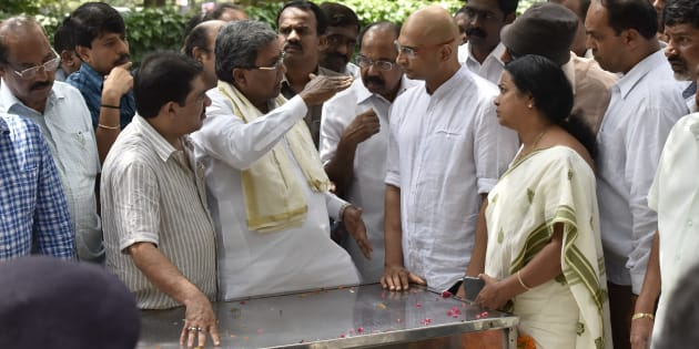 Karnataka chief minister Siddaramaiah speaks to Indrajit brother of the slain journalist Gauri Lankesh as her mortal remains kept at Town hall on September 6, 2017 in Bengaluru, India.