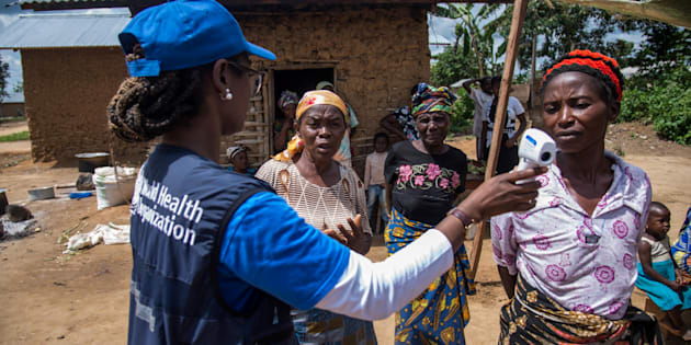 Dr. Marie-Roseline Darnycka Bélizaire, World Health Organisation (WHO) Epidemiology Team Lead, talks to women as part of Ebola contact tracing, in Mangina, Democratic Republic of Congo August 26, 2018. Picture taken August 26, 2018.   WHO/Junior Kannah/Handout via REUTERS ATTENTION EDITORS - THIS IMAGE HAS BEEN SUPPLIED BY A THIRD PARTY.