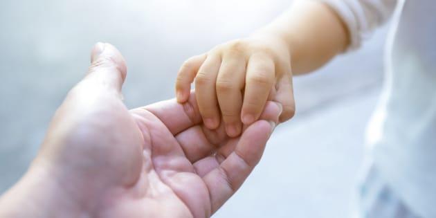 holding baby hand