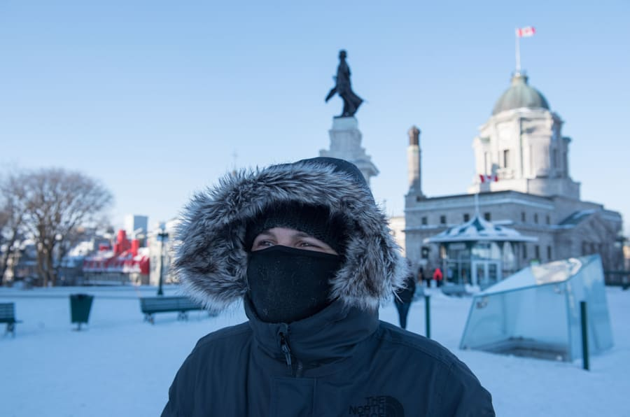 A woman walks through snow on a cold day in Quebec City on Wednesday.