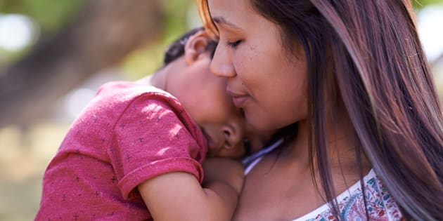 Shot of a little boy being comforted by his mother.
