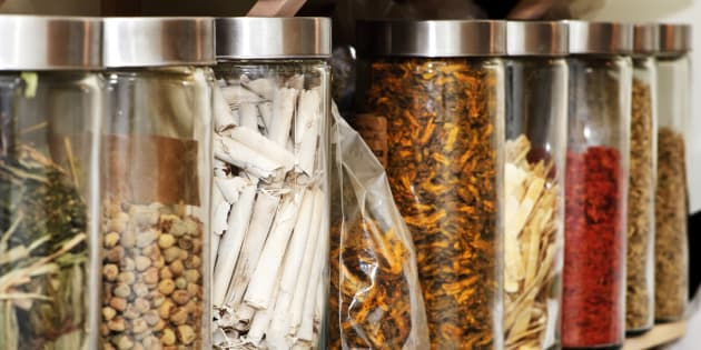 Traditional chinese medicine herbs and remedies in jars.