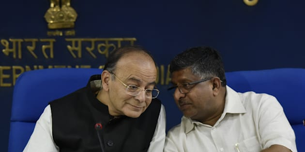 Finance Minister Arun Jaitley with Union Minister holding Law and Justice and Ministry of Information Technology Ravi Shankar Prasad.