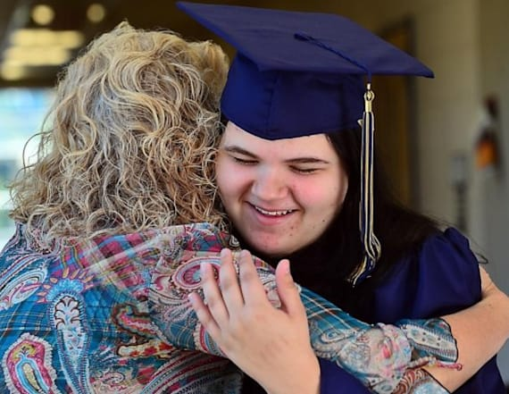 Girl who lived in motels for 15 years graduates