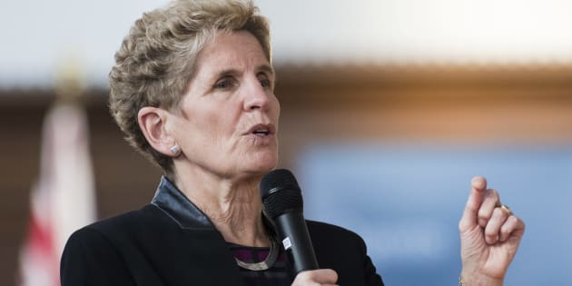 "Ontario's Premier Kathleen Wynne speaks at town hall Q&A at Queen's University in Kingston, Ont., Wed. Feb. 14. There is ""little evidence"" that the minimum wage hike Wynne's government introduced last month is behind the province's steep job losses, Scotiabank says."