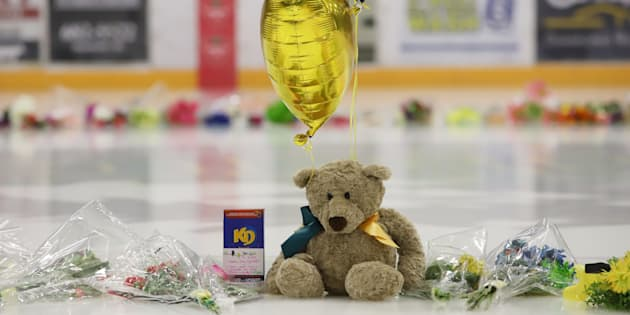 Flowers, cards and sentimental gifts adorn the ice surface at Humboldt Uniplex during preparations for a prayer vigil for the Humboldt Broncos ice hockey team, on Sunday.