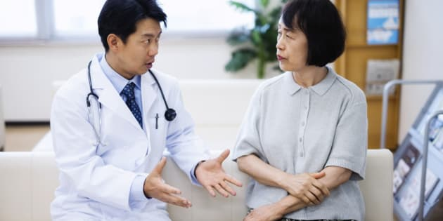 japanese doctor explaining senior patient