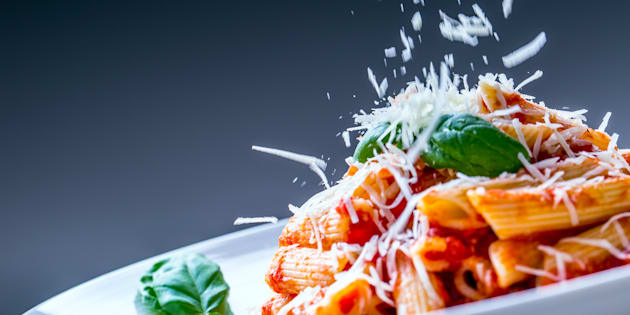 Pasta Penne with Tomato Bolognese Sauce, Parmesan Cheese and Basil Leaves. Mediterranean food.Italian cuisine.Pasta Penne with Tomato Bolognese Sauce, Parmesan Cheese and Basil Leaves. Mediterranean food.Italian cuisine.