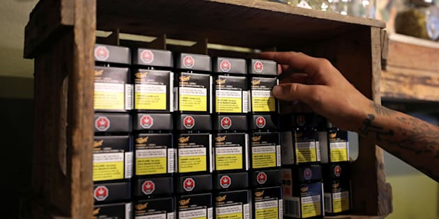 An employee arranges products from cannabis brand Tweed at a retail store in Portugal Cove-St. Philip's, Nfld., Oct. 17, 2018. Ontario is reviewing the first applications for brick-and-mortar stores in the province.