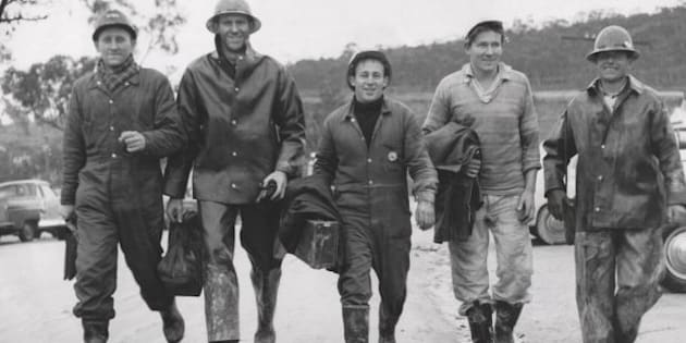 Workers return after a day's work in June 1957 on the snowy mountains.