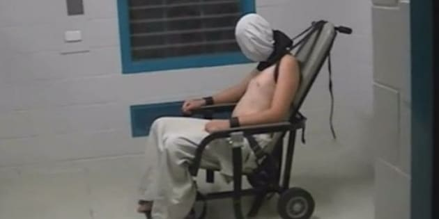 A teenage boy pictured strapped to a chair in the NT Don Dale centre