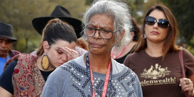 Jenny Munro and delegates address the media after walking out of the First Nations National Convention at Uluru. Photo: Alex Ellinghausen