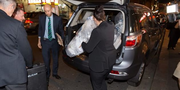 AFP officers load bags of shredded documents into a van during a raid on AWU offices on Tuesday.