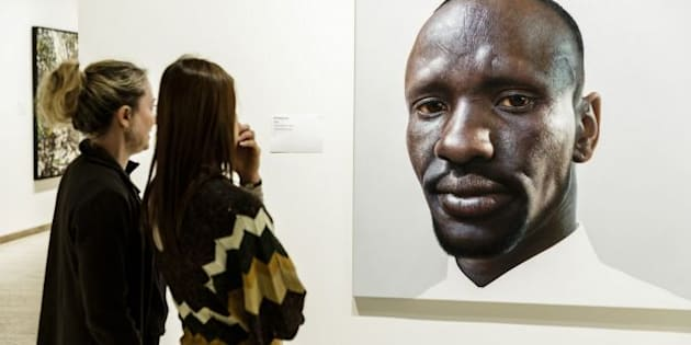 Sydney artistNick Stathopoulos spent four months painting the Sudanese refugee.