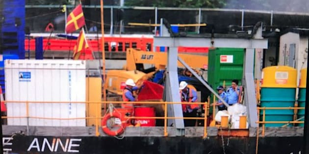 Police and workers gather on a barge where a man died at Barangaroo. Photo: David Porter