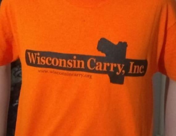 Schools sued for allegedly banning gun T-shirts