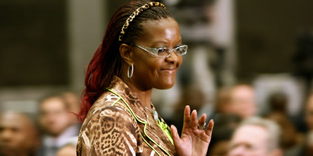 Grace Mugabe, wife of Zimbabwean President Robert Mugabe, waves on arrival for the opening of the summit of the Southern African Development Community (SADC) in Johannesburg, August 16, 2008.  REUTERS/Mike Hutchings (SOUTH AFRICA)