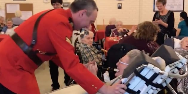 Cpl. Daryl Chernoff takes 100-year-old Elsie Shepherd for a glide around the dance floor at her birthday party.