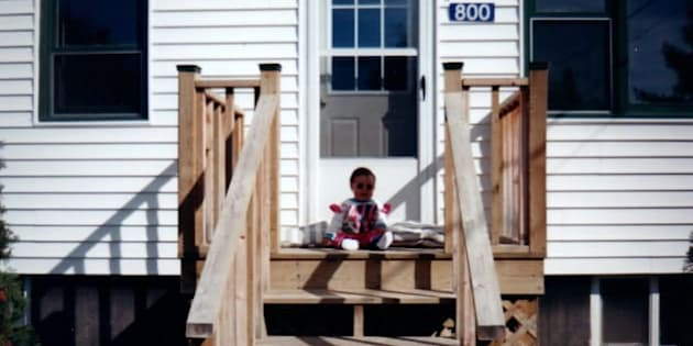 Author Haley Lewis sitting on the porch of her family home in Taymouth, N.B.