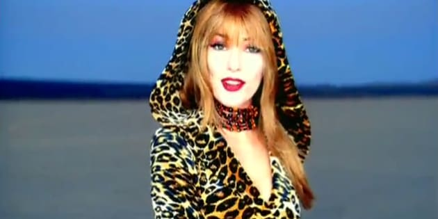 "Shania Twain in her iconic hooded leopard skin outfit from the music video ""That Don't Impress Me Much""."