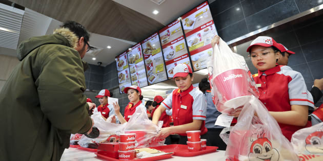 Customers and servers at a Jollibee location in Greater Toronto. The Filipino fast food chain has announced plans to open 100 locations in Canada.