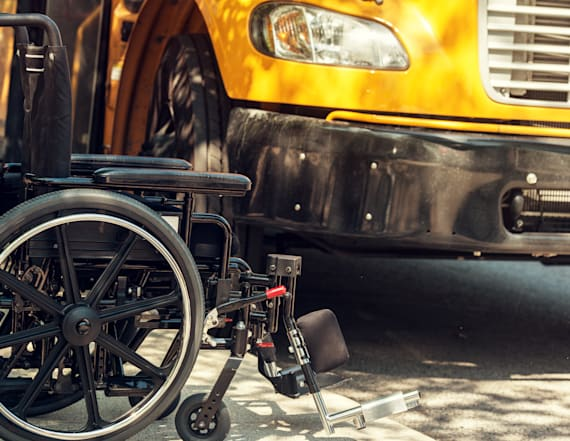 Wheelchair-bound girl left on school bus for hours