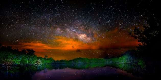 Brush fires in Everglades National Park make for a dramatic Milky Way in this panorama.