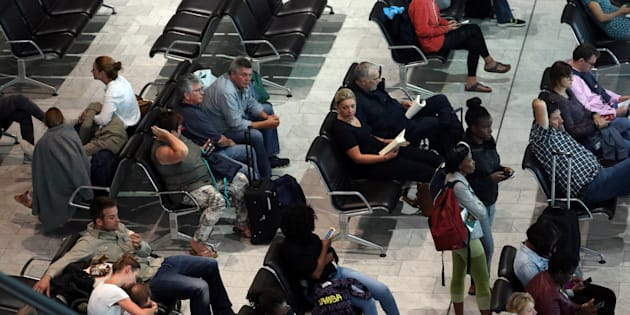 Passengers wait for their flights at the Cape Town International Airport in Cape Town, South Africa, January 12, 2018.