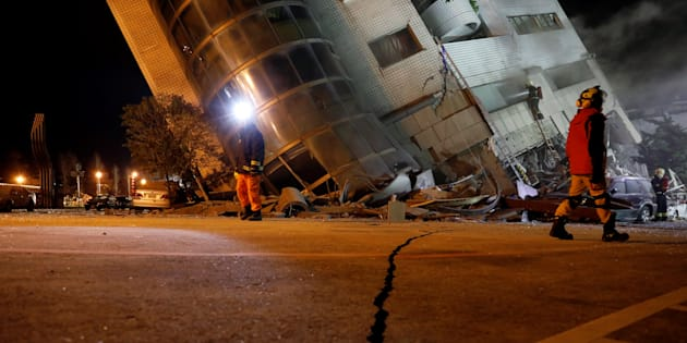 Rescue personnel search a collapses building after an earthquake hit Hualien, Taiwan February 7, 2018.