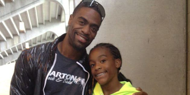 Sprinter Tyson Gay with daughter, Trinity Gay