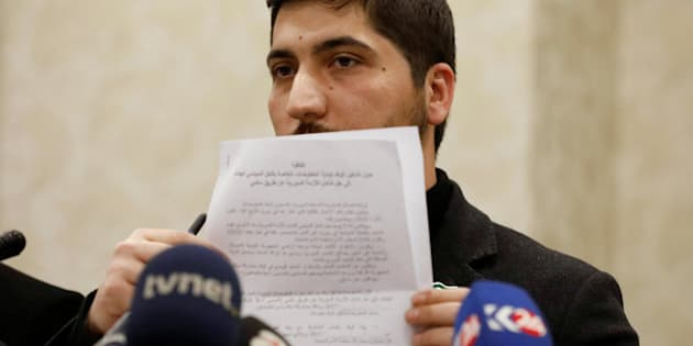 Osama Abu Zaid, a spokesman for the Free Syrian Army rebel alliance, shows the text of the agreement about a ceasefire between Syrian opposition groups and the Syrian government during a news conference in Ankara, Turkey, December 29, 2016.