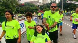 Henrique Fogaça participa com filha de corrida no Dia Internacional das Pessoas com