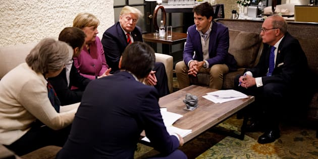 Canada's Prime Minister Justin Trudeau and G7 leaders France's President Emmanuel Macron, Germany's Chancellor Angela Merkel, Britain's Prime Minister Theresa May and U.S. President Donald Trump hold a meeting with staff on the first day of the G7 meeting in Charlevoix city of La Malbaie, Quebec, Canada, June 8, 2018. Picture taken June 8, 2018.  Adam Scotti/Prime Minister's Office/Handout via REUTERS. ATTENTION EDITORS - THIS IMAGE WAS PROVIDED BY A THIRD PARTY.